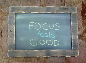 """Focus feels good"" written on a chalkboard"